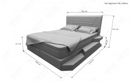 Lit boxspring NEMESIS en cuir avec topper & port USB NATIVO™ Möbel Schweiz